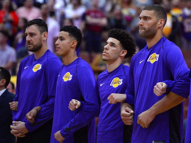 Los Angeles Lakers teammates Andrew Bogut (far L), Kyle Kuzma, Lonzo Ball and Brook Lopez lock arms during the national anthem.