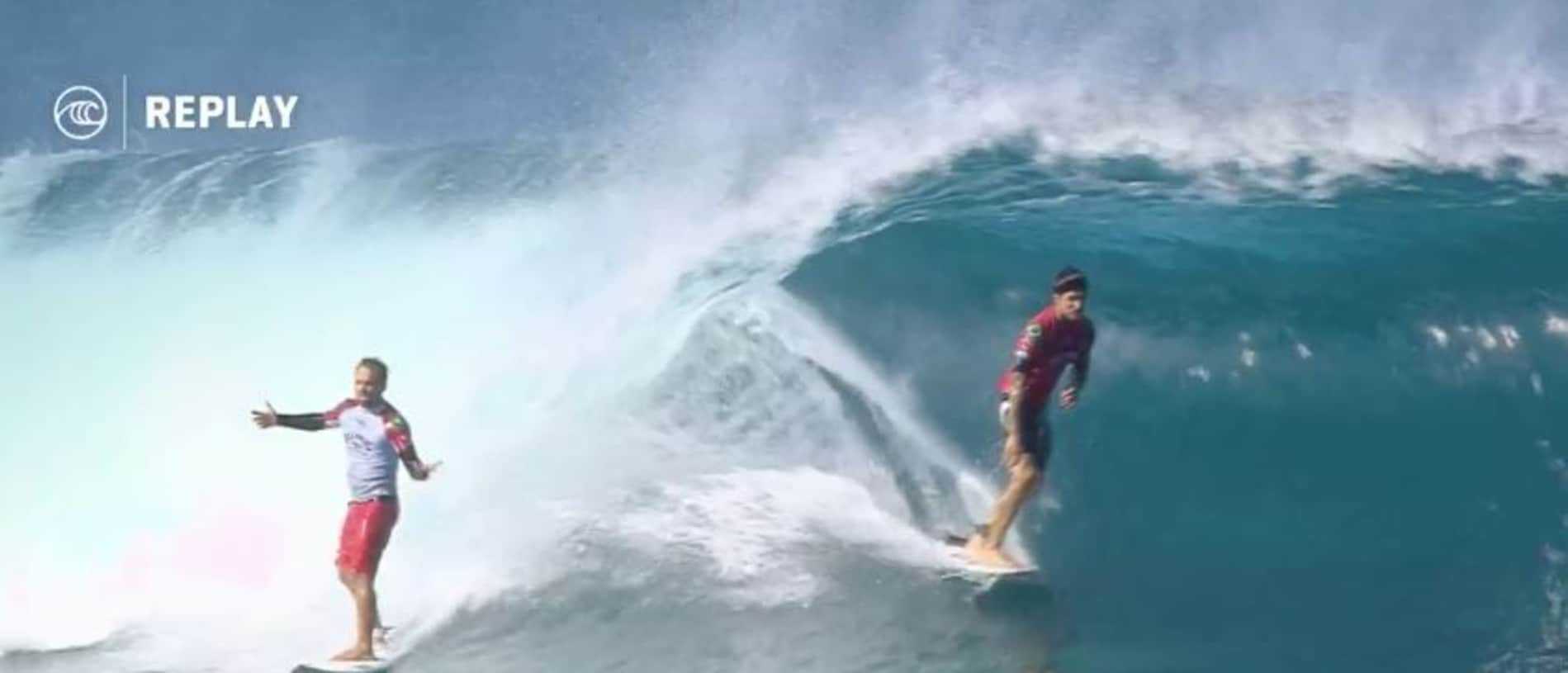 Caio Ibelli objects as Gabriel Medina drops in.
