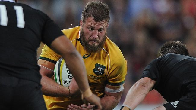James Slipper of the Wallabies takes on the All Blacks defence in 2014.