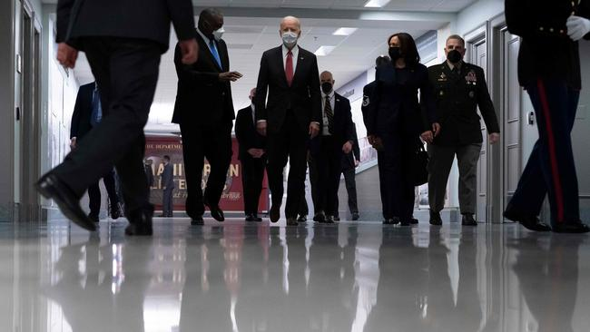 US President Joe Biden, centre, accompanied by Vice President Kamala Harris. Picture: Alex Brandon/AFP