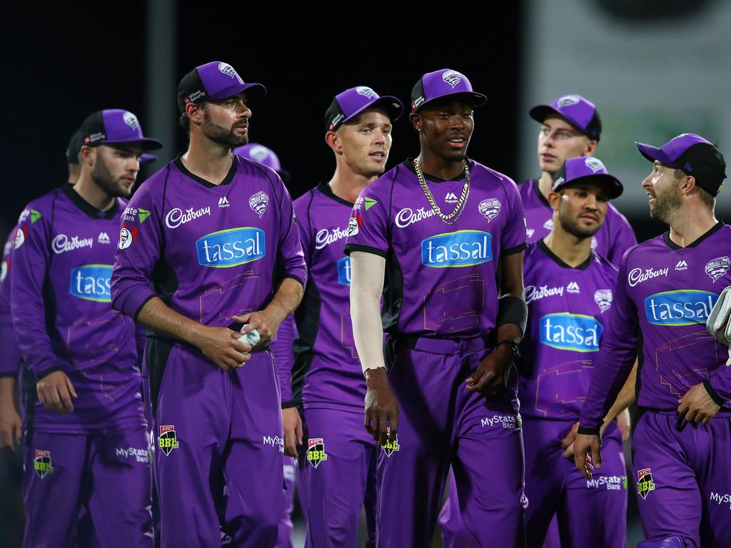 HOBART, AUSTRALIA — FEBRUARY 07: Matthew Wade of the Hurricanes leads Jofra Archer and Hurricanes players from the field after winning the Hurricanes v Renegades Big Bash League Match at Blundstone Arena on February 07, 2019 in Hobart, Australia. (Photo by Scott Barbour/Getty Images)