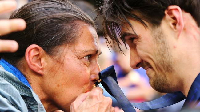 Easton Wood celebrating his premiership win with his mum. Picture: Darrian Traynor/Getty