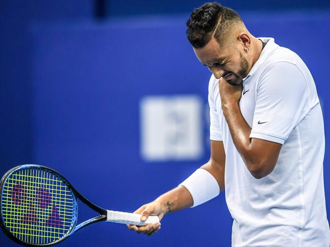 Nick Kyrgios clutches his shoulder during his loss at the Zhuhai Championships.