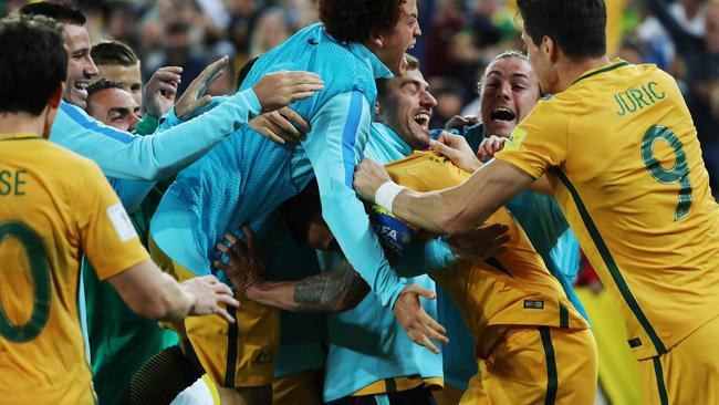Socceroos Tim Cahill celebrates after scoring his second goal during the Socceroos v Syria World Cup Qualifier at ANZ Stadium, Sydney. Picture: Brett Costello