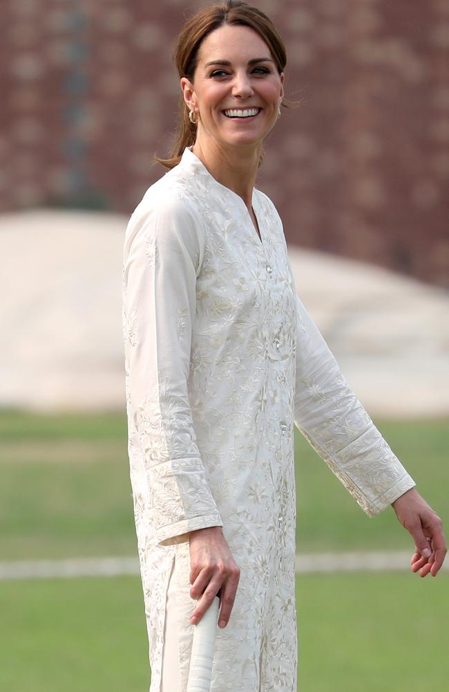 Kate laughed along with locals while playing cricket at the National Cricket Academy in Lahore. Picture: Getty Images.
