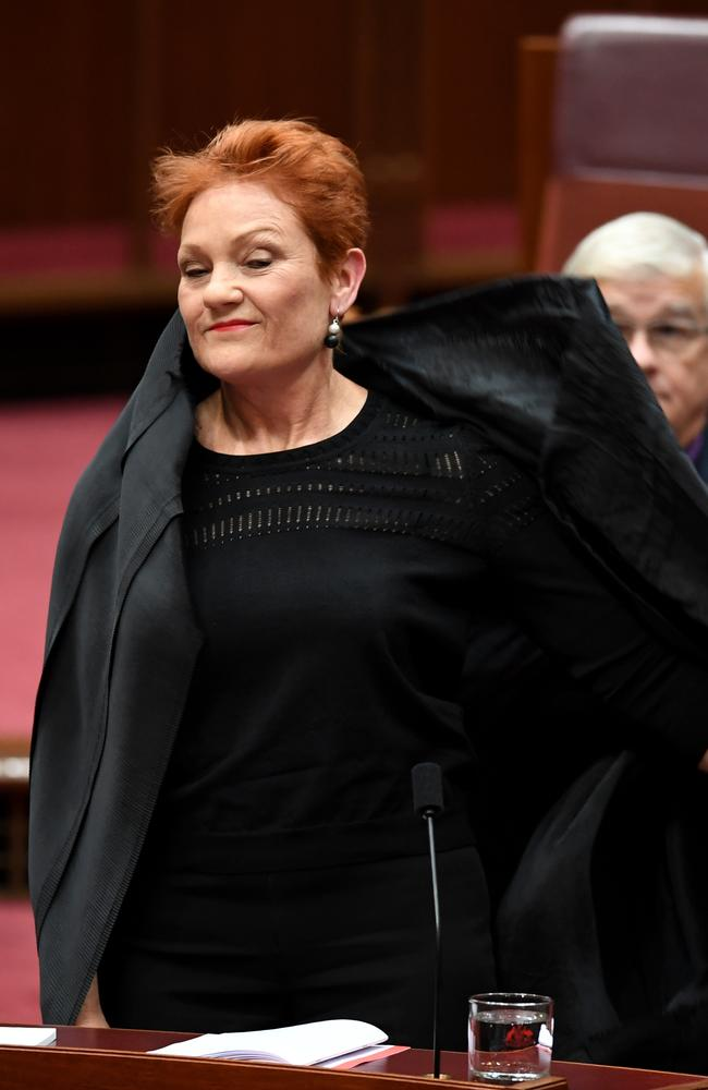 Hanson emerges after taking off the burqa. Picture: AAP