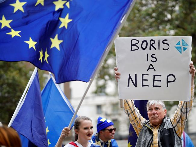Anti-Brexit activists, and demonstrators opposing the British government's actions in relation to the handling of Brexit, protest near Downing Street in central London. Picture: AFP