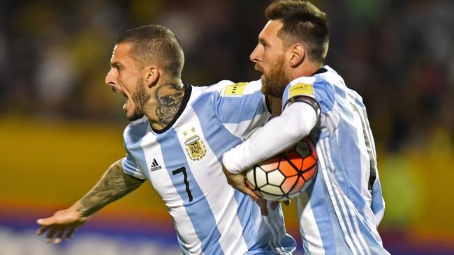 Argentina's Lionel Messi (R) celebrates with teammate Dario Benedetto.