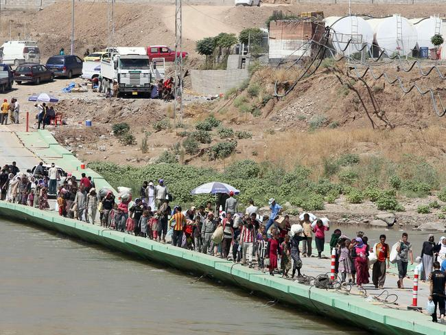 At least 20,000 civilians, most of whom are from the Yazidi community, have safely escaped to Syria. Pic: AFP.