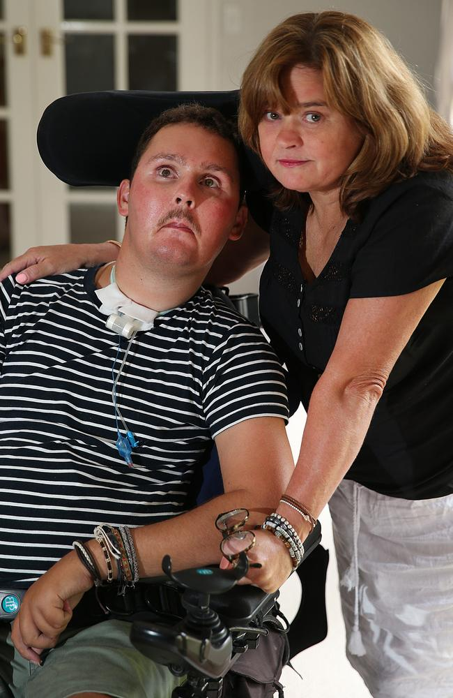 Katie Ballard with her son Sam who was left severely disabled after swallowing a slug and had his NDIS package slashed.