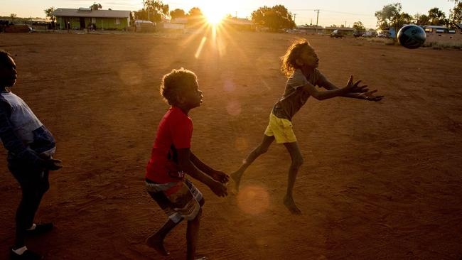 Children play AFL in Yeundumu. Picture: Jason Edwards