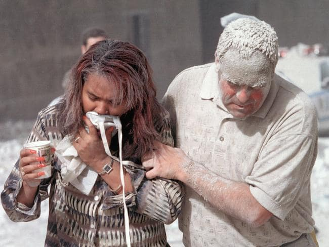 An ash-covered man helps a woman following the terrorist attack on the World Trade Centre in New York City on September 11, 2001. Picture: Don Halasy/Alamy