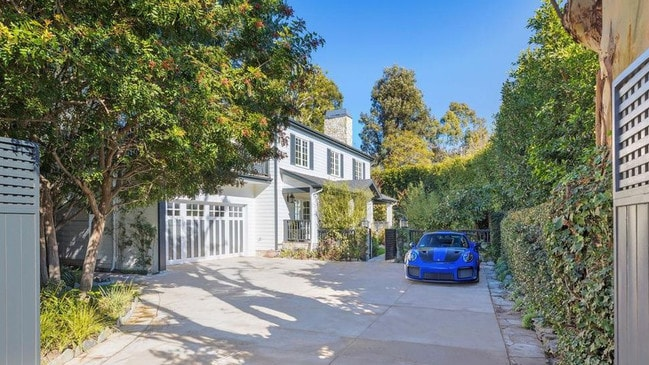 Another one of Button's many cars parked inside his LA home. Picture: Realtor.com