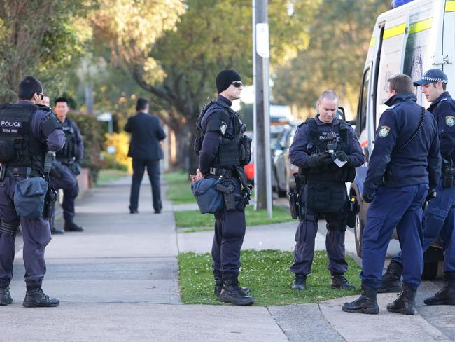 NSW Police and Australian Federal Police at a searched address at Hector Street, Bass Hill.