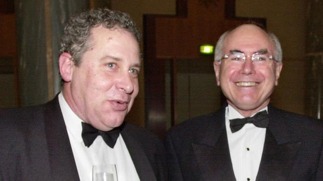 Malcolm Farr with Prime Minister John Howard at Parliament House's Midwinter Ball in 2002.