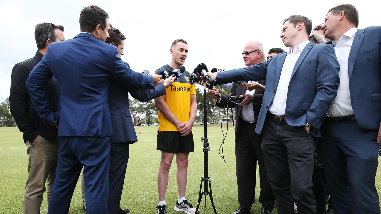 Tom Scully speaks to media during a training session at Xavier College in December.