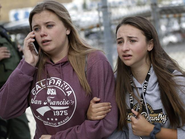 Students are escorted outside of Saugus High School after reports of a shooting. Picture: AP