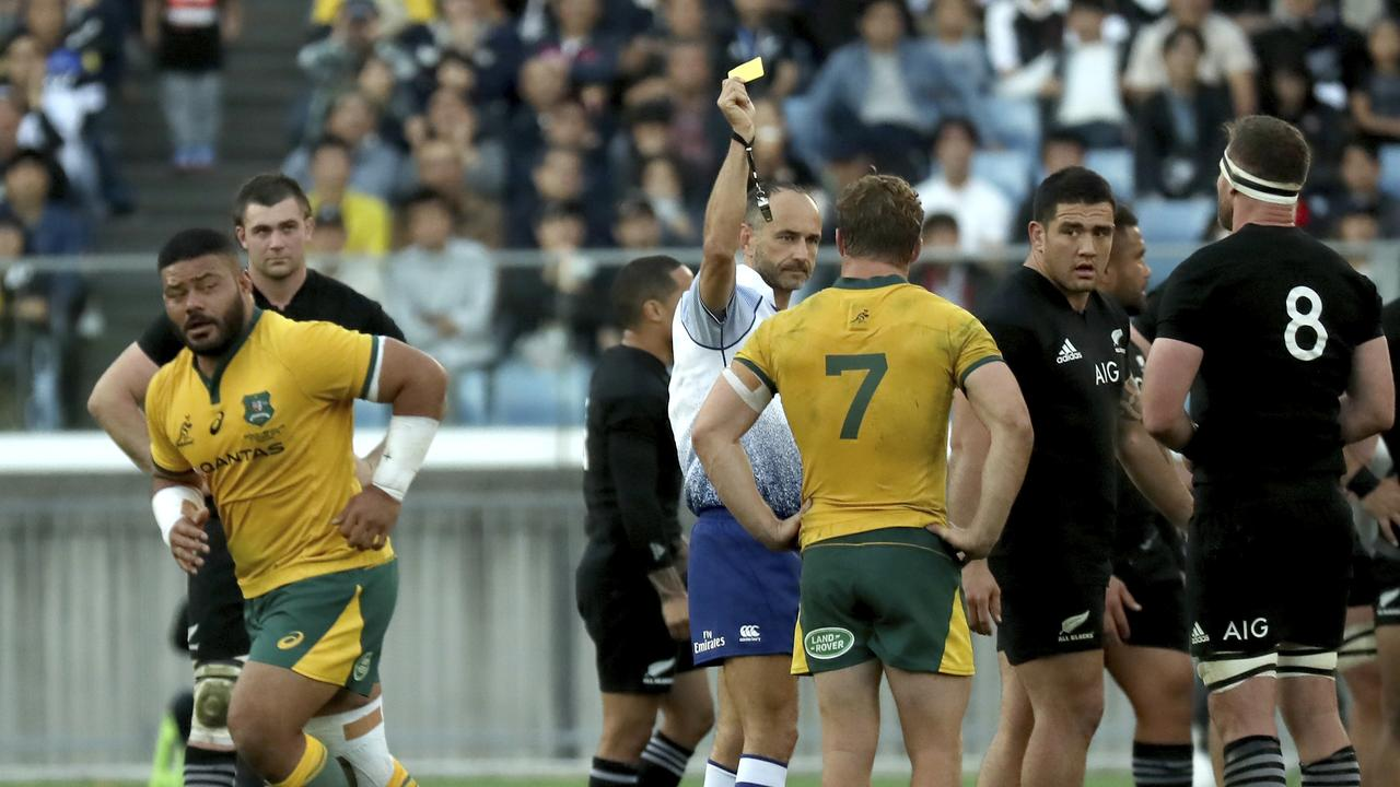 Referee Romain Poite shows Australia's Tolu Latu a yellow card in Yokohama.
