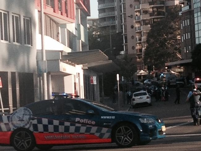 Two people are dead and one officer has been injured in a shooting outside the NSW Police headquarters.