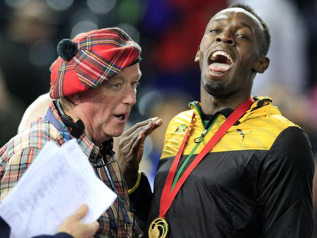 Jamaica's Usain Bolt jokes as he is pulled over for a TV interview after getting his gold medal.