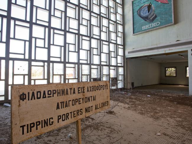 A sign from before the airport was mostly abandoned in 1974. Picture: Athanasios Gioumpasis/Getty Images