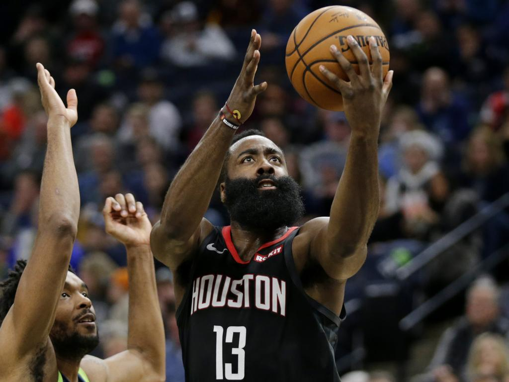 Houston Rockets guard James Harden (13) shoots on against Minnesota Timberwolves guard Keita Bates-Diop in the third quarter during an NBA basketball game Saturday, Nov. 16, 2019 in Minneapolis. The Rockets defeated the Timberwolves 125-105 with Harden scoring a game-high 49 points. (AP Photo/Andy Clayton- King)