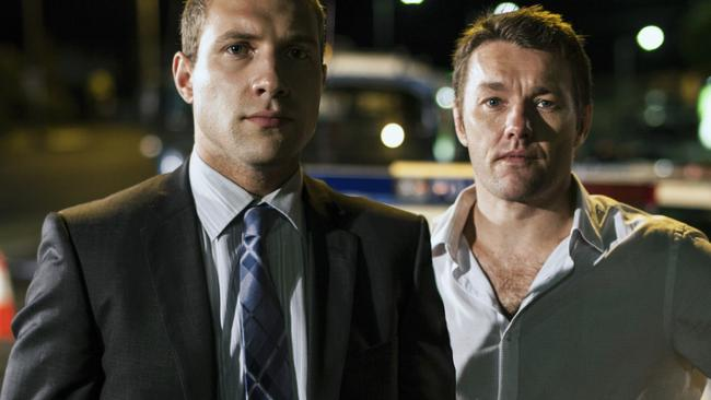Driver's seat ... Edgerton with Jai Courtney (left) in Felony. Picture: Roadshow
