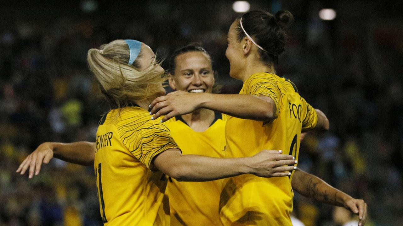 Caitlin Foord celebrates with team mates as the Socceroos ran riot in the second half.