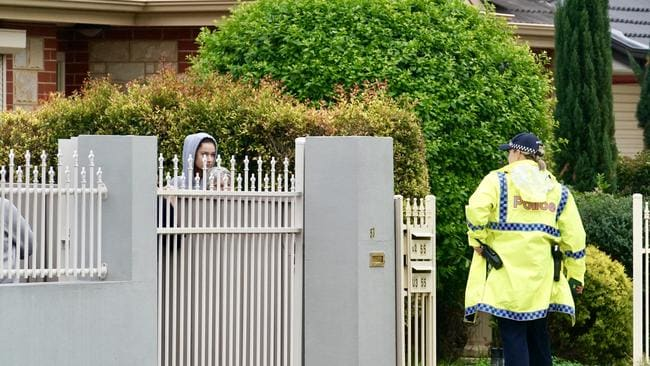 Police talk to locals at the Seaton shooting scene. Picture: Mike Burton