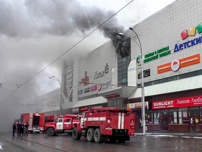 Emergency services gather outside a burning shopping centre in Kemerovo. Picture: AFP/Russian Emergency Situations Ministry