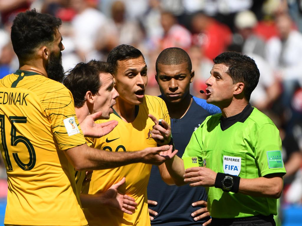 Australia's Mile Jedinak, Robbie Kruse and Trent Sainsbury argue with match referee Andres Cunha after France were awarded a penalty and scored during their FIFA World Cup group match at Kazan Arena during the FIFA 2018 World Cup in Kazan, Russia, Saturday, June 16, 2018. (AAP Image/Dean Lewins) NO ARCHIVING