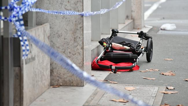 A smashed pram at the scene of the crash. Picture: Jake Nowakowski