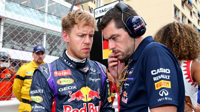 Vettel with race engineer Guillaume Rocquelin on the grid at Monaco.