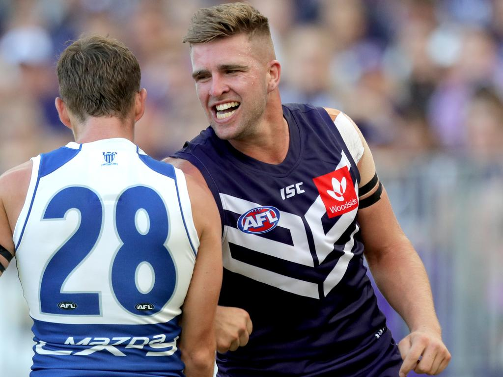 Luke Ryan (right) of the Dockers and Kayne Turner of the Kangaroos tussle during the Round 1 AFL match between the Fremantle Dockers and the North Melbourne Kangaroos at Optus Stadium in Perth, Sunday, March 24, 2019. (AAP Image/Richard Wainwright) NO ARCHIVING, EDITORIAL USE ONLY