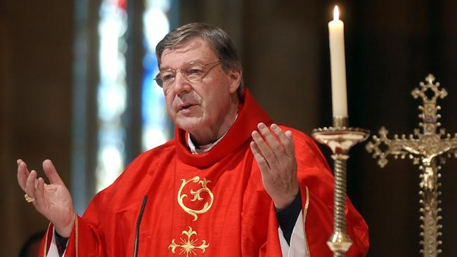 Pell celebrates mass in Sydney's St. Mary's Cathedral. Picture: AP Photo/Rick Rycroft.