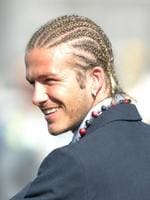 <p>2003: England football team in South Africa. England Captain David Beckham with his latest hairstyle (braided), smiling as he arrives in South Africa, where he will meet Nelson Mandela.</p>