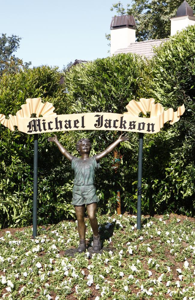A statue of a young child stands near a Michael Jackson sign on the Neverland Ranch. Picture: Trae Patton/NBC/NBCU Photo Bank/Getty Images