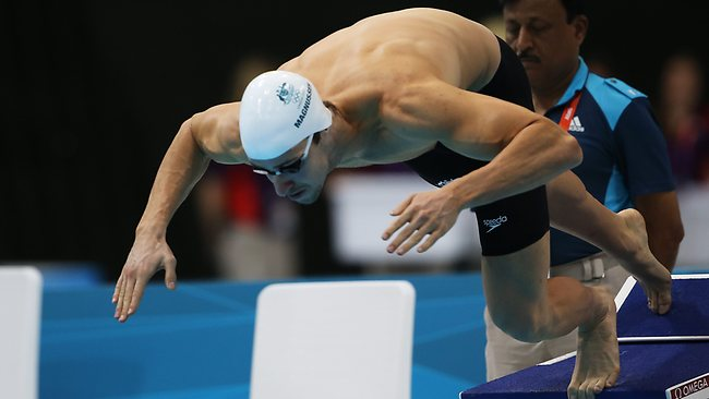 Australia's James Magnussen dives in at the start of his 100m freestyle heat. Picture: Phil Hillyard