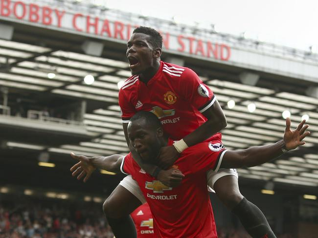 Manchester United's Romelu Lukaku celebrates scoring his side's second goal of the game with Paul Pogba (top).