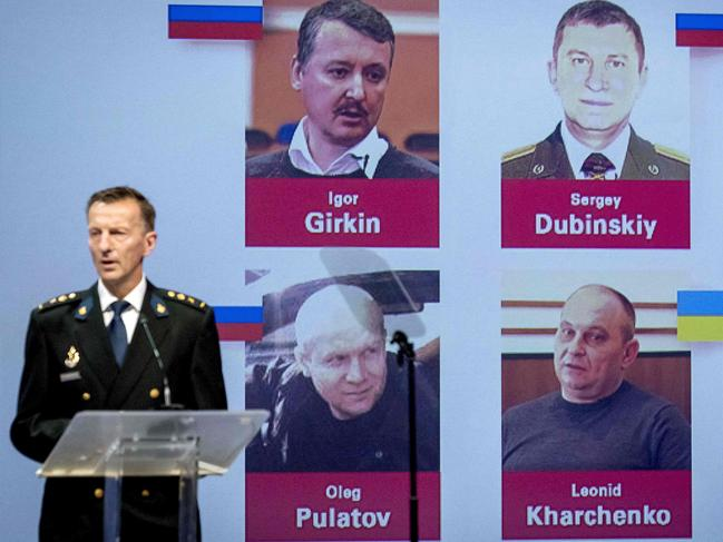 Dutch police chief Wilbert Paulissen unveils photos of the four suspects accused of murder over the downing of MH17. Picture: Robin van Lonkhuijsen / ANP / AFP