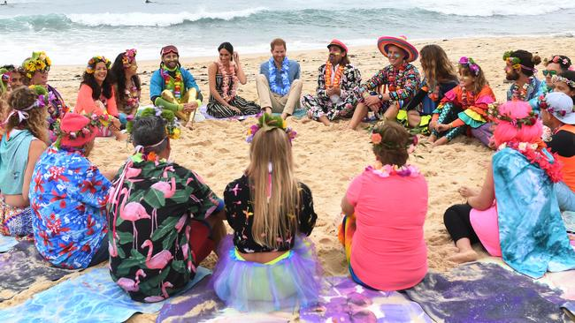 Harry and Meghan take part in a Fluro Friday session run by OneWave, a local surfing community group raising awareness for mental health and wellbeing, at Bondi Beach Picture: Dean Lewins