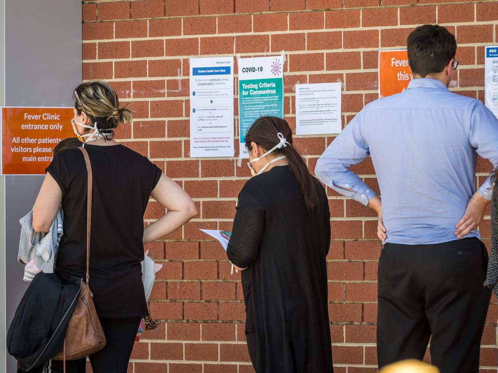 People queue outside a for a fever clinic at Epping Hospital. Picture: Jake Nowakowski