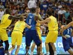 Philippine (blue) and Australian (yellow) players engage in a brawl during their FIBA World Cup Asian qualifier game at the Philippine arena in Bocaue town, Bulacan province, north of Manila on July 2, 2018. Australia won by default 89-53. / AFP PHOTO / TED ALJIBE