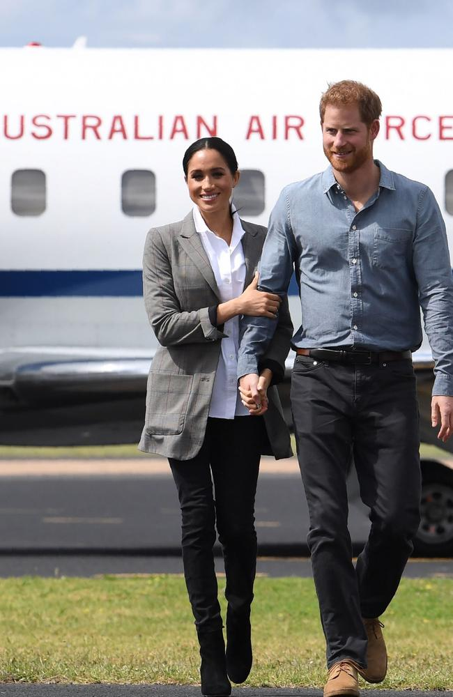 Harry and Meghan in Dubbo with the Duchess in the Outland jeans which have since seen their sales surge. Picture: Dean Lewins. Source: AFP