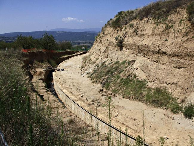 Outer wall ... A partial view of the site where archaeologists are excavating an ancient mound in Amphipolis, northern Greece. Source: AP