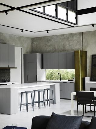 Concrete walls are left exposed in this interior by designer Fiona Lynch.