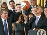 President Barack Obama tosses up a basketball given to him by coach Geno Auriemma (L) while honoring the 2015 NCAA Women's Basketball Champion University of Connecticut Huskies during a ceremony in the East Room at White House September 15, 2015 in Washington, DC. Picture: Mark Wilson/Getty Images