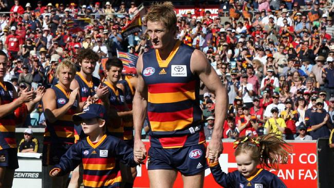 Ben Hart runs out for his 300th AFL game with son Zac and daughter Imogen in 2006.