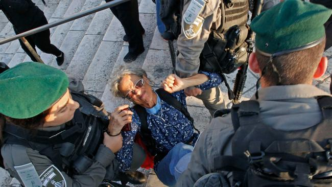 Members of the Israeli security forces detain a woman as they disperse a demonstration outside the Damascus Gate in the old city of Jerusalem. Picture: AFP
