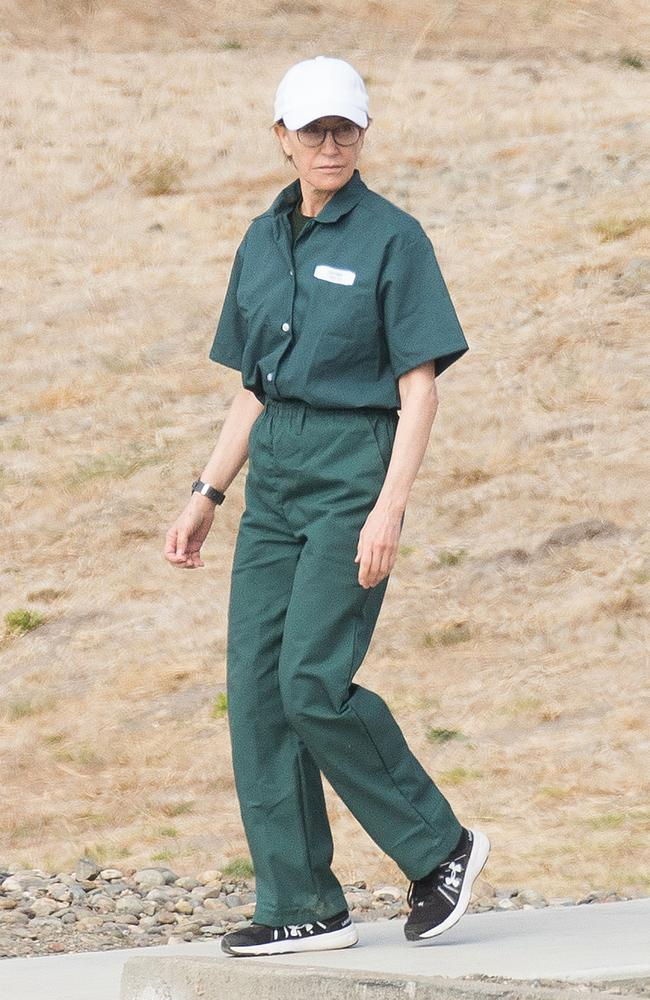 Felicity Huffman wears a prison jumpsuit while serving out her sentence on federal charges. Picture: SplashNews.com